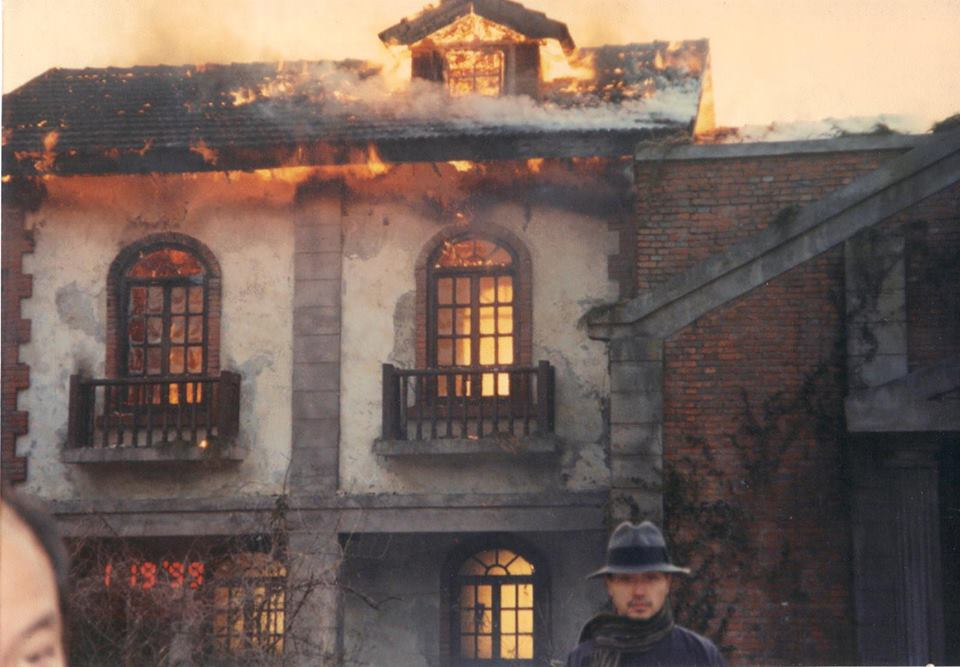 Leslie exiting the burning house. I admire his poise because the crew was running out like mad becau ...